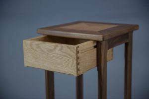 Oak side table with drawer